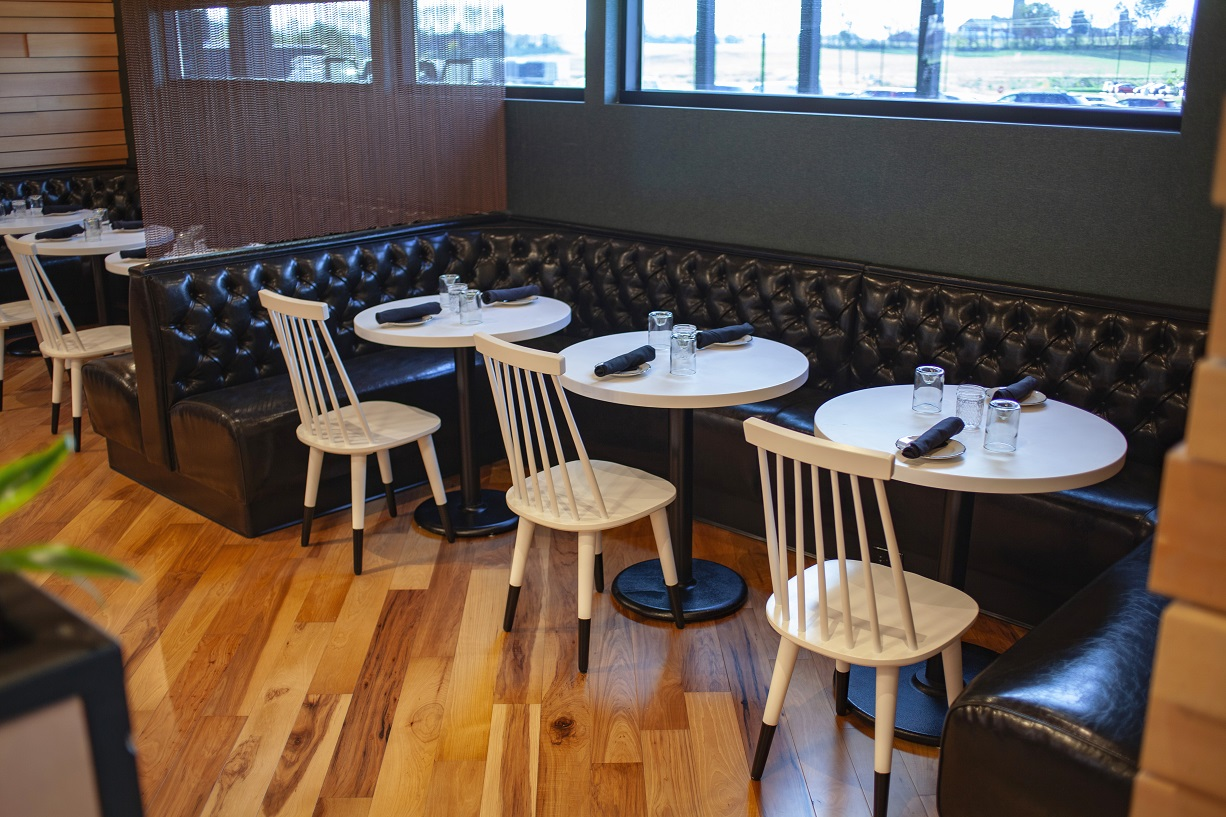 Per Diem's beautiful interior featuring chairs and bench seating