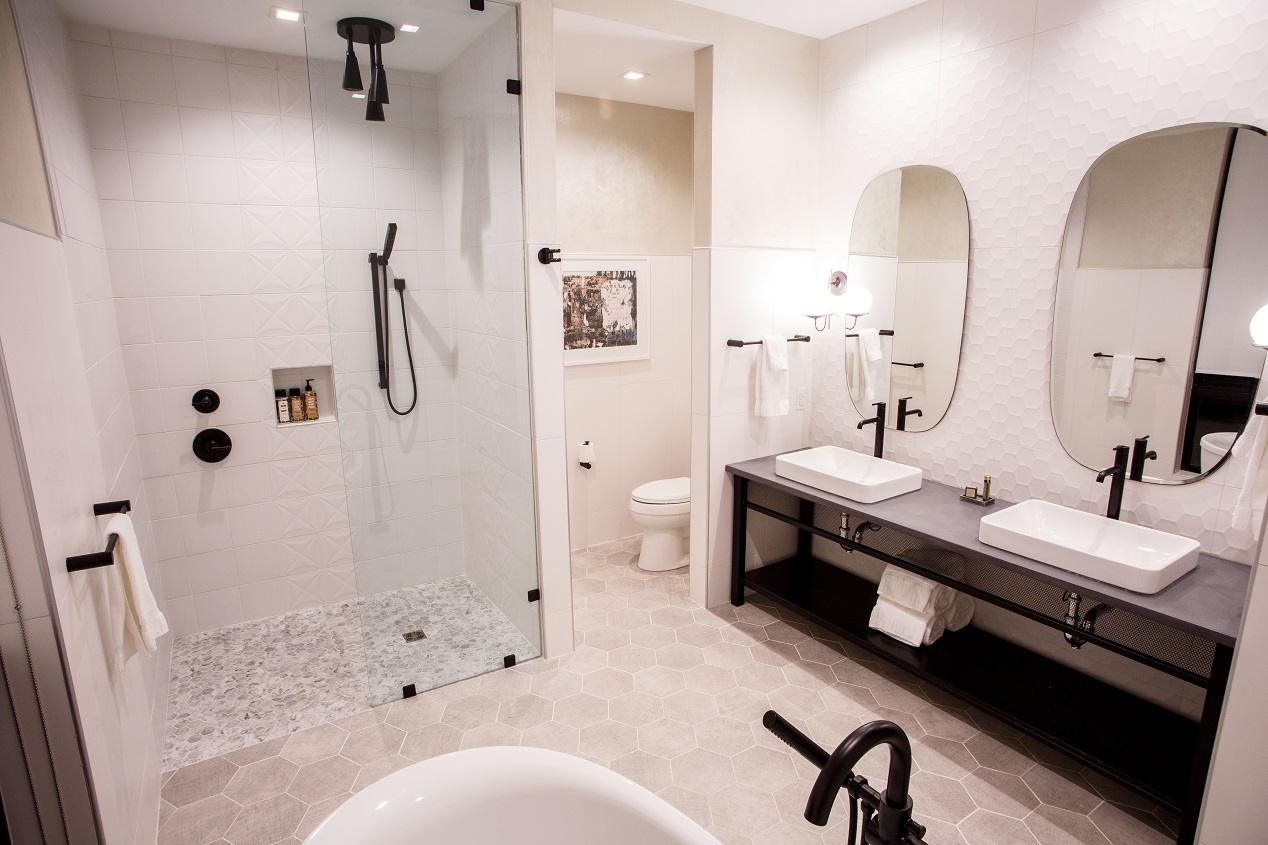 Hotel Rock Lititz Penhouse Suite beautiful white bathroom featuring full bathtub and standing shower